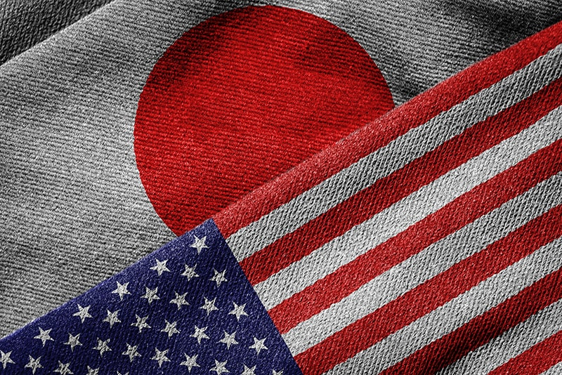 Flags of USA and Japan. While both have a democray Japan is very different in how they look at their candidates.