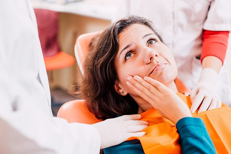 Woman sitting in dental chair worried about her upcoming procedure. With the modern anesthesia and sedation dentistry options that Dr. Robert W. Fornalczyk, DDS offers in his Butler, PA office you'll be at ease.