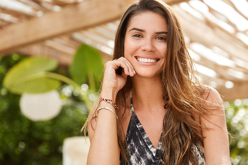 attractive woman enjoys the sun during summer